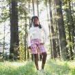 Stock Photo: Africgirl standing in woods