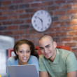African American couple with laptop — Stock Photo