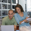 African American couple looking at laptop — Stock Photo