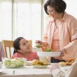 Hispanic family at dinner table — Stock Photo