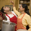 Hispanic couple preparing food — Stock Photo