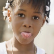 African girl sticking out tongue — Stock Photo