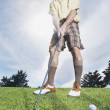 Man swinging golf club — Stock Photo