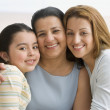 Hispanic grandmother, mother and daughter hugging — Stock Photo