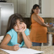 Stock Photo: Hispanic girl coloring in kitchen