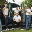 Multi-generational Hispanic male family members in front of truck — Stock Photo