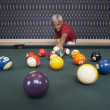 Senior man playing pool — Stock Photo
