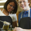 Multi-ethnic teenagers in science class — Stock Photo