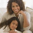 African girl leaning on mother's lap — Stockfoto