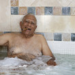Senior Mixed Race min hot tub — Stock Photo #23326088