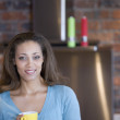 African American woman holding coffee mug — Stock Photo