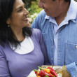 Hispanic couple holding peppers — Stock Photo