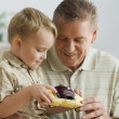 Grandfather and grandson looking at toy car — Stock Photo