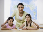 Mixed Race female teacher and multi-ethnic female students — Stock Photo