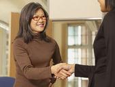 Asian businesswoman shaking hands — Stock Photo