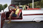 Hispanic woman sitting in convertible — Stock Photo