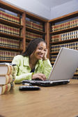 African American woman typing on laptop — Stockfoto