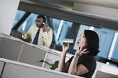 Multi-ethnic businesspeople talking in can and string telephone — Stock Photo