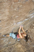 Asian woman rock climbing — Stock Photo