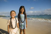 Pacific Islander sister and brother at beach — Stock Photo