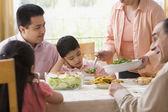 Hispanic family at dinner table — Stock Photo