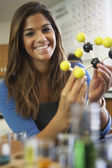 Mixed Race teenaged girl in science class — Stock Photo