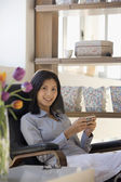 Asian businesswoman holding electronic organizer — Stock Photo