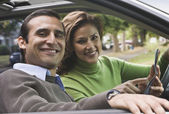 Hispanic coupe holding map in car — Stock Photo