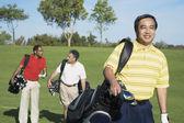 Multi-ethnic men on golf course — Stock Photo