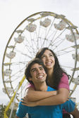 Multi-ethnic teenaged couple at carnival — Stock Photo