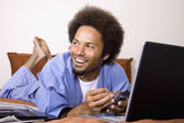 African man using electronic organizer — Stock Photo