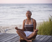 Senior African American woman meditating — Stock Photo