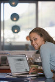 African American woman next to laptop — Stock Photo