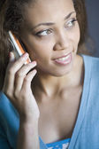 African American woman talking on cell phone — Stok fotoğraf