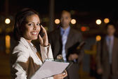 African American businesswoman talking on cell phone — Stock Photo