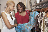 Senior African American women clothes shopping — ストック写真