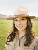 Hispanic female park ranger in field — Stock Photo