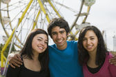 Multi-ethnic teenaged friends at carnival — Stock Photo