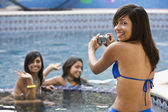 Hispanic teenaged girls in swimming pool — Stock Photo