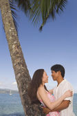 Asian couple hugging at beach — Stock Photo