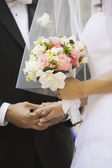 Close up of bride holding bouquet — Stock Photo