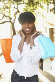 African woman holding shopping bags — Stock Photo