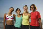 Multi-ethnic female runners at beach — Stock Photo