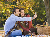 Hispanic couple taking own photograph — Stock Photo