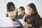 Asian businesswoman reading paperwork — Stock Photo