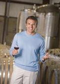 Hispanic male vintner holding glass of wine — Stock Photo