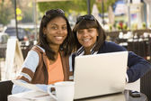 African teenaged girls next to laptop — Stock Photo