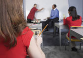 Multi-ethnic adult students in class — Stock Photo