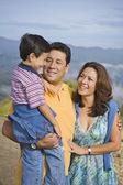Hispanic family hugging — Stock Photo