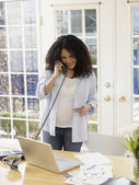 Pregnant African woman shopping on telephone — Stock Photo